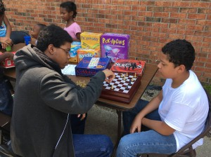Jeremiah Perez, 13, and Dayvon Rogers, 14, duel each other in a game of chess during the Back 2 School Bash at EB Jordan Homes. The back to school event was sponsored by the community's Resident Council and featured games, food, music and a school supply give away for the families in the neighborhood.