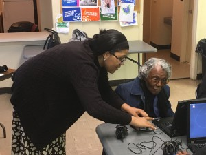 Digital Learning instructor Beverly Williams, who is a resident of public housing, gives some hands-on help to Mattie Clay at the Wilson Housing Authority's first digital learning class at Whitfield Homes Community Center. Clay, 86, said the chance to learn about computers and get the laptop when she was done with the classes pushed her out of the house to attended the digital training.