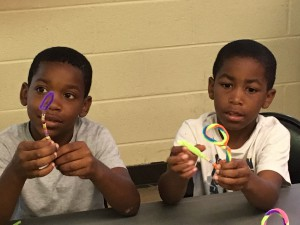 Xzayvion Harris, 8 (at left), and Jonquaviua Harris, 7, shaper thier pipe cleaner bubble blowers during the Arts Camp at Whitfield Homes